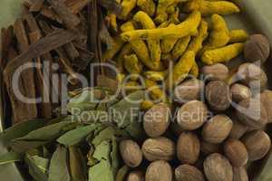 Nutmeg, bay leaf, cinnamon stick and turmeric