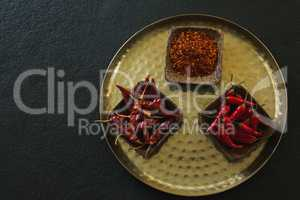 Red Chilies, dried red chili pepper and crushed red pepper in plate