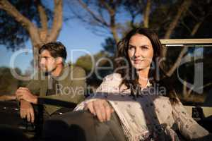 Portrait of confident woman sitting in vehicle