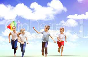 Composite image of full length of boy holding kite running with friends