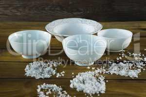 Bowls and sea salt scattered