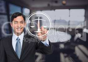 smiling businessman pointing at justice icon