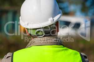 Construction Worker In Hard Hat On Building Site