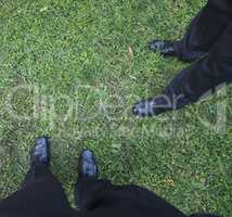 men on the grass with copy space
