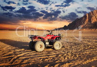 Quad bike in sand desert