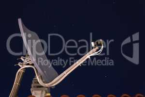 satellite dish receiver ina a starred night