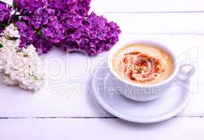 Cappuccino in a white cup and saucer