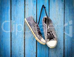 old men's shabby textile sneakers hang