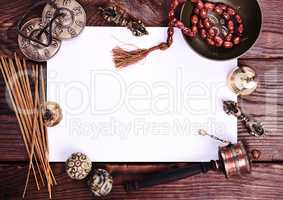blank white sheet and antique religious objects