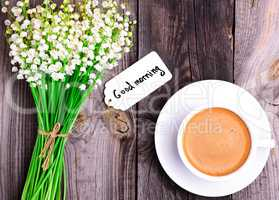 cappuccino cup with saucer and bouquet