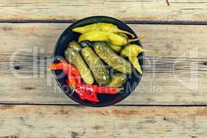 American traditional snack. Pickled cucumbers and salted hot chilli pepper