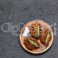 Sirloin steaks on plate