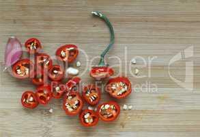 Hot chili pepper chopped on a cutting board
