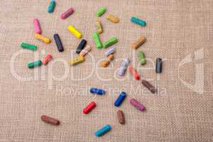 Crayons of various color on a canvas