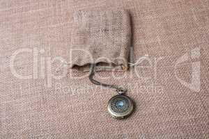 Mechanical pocket watch on a sack on  canvas
