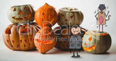 Cartoon children standing on halloween pumpkins