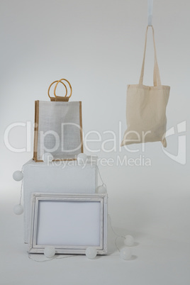 Bags and picture frame decorated with lights