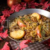 Fried liver with onion apple and herbs.