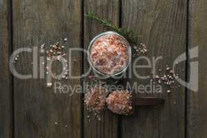 Himalayan salt and rosemary on wooden table