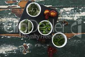 Various spices and herbs on wooden table