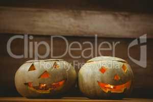 Illuminated jack o lanterns on table during Halloween