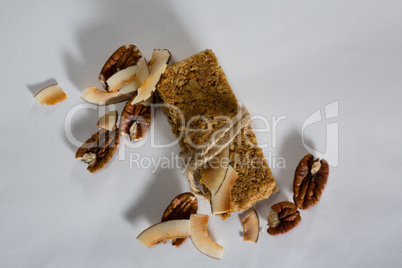Granola bar tied with string and dried fruits kept around