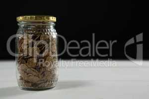 Wheat flakes in glass jar