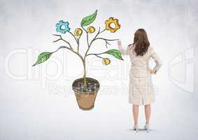 Woman holding pen and Drawing of Business graphics on plant branches on wall