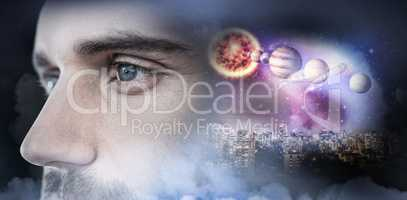Composite image of man with blue eyes looking away