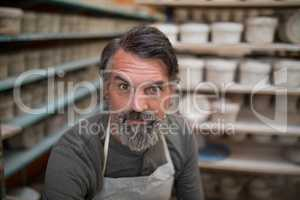 Male potter in pottery workshop