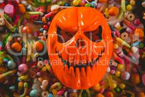 Overhead view of monster mask with various candies