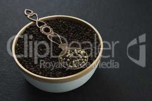 Black pepper and white pepper seeds in a bowl