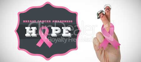Composite image of cropped hand with breast cancer awareness ribbon