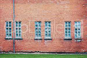 Abandoned architecture background with brick wall and windows