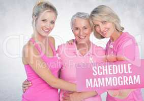 Schedule mammogram Text and Hand holding card with pink breast cancer awareness women