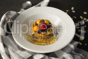 Plate of breakfast cereals with fruits