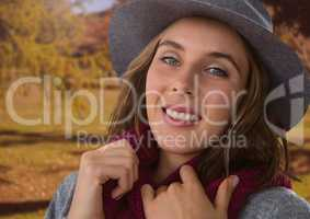 Woman in Autumn with hat and scarf in nature park