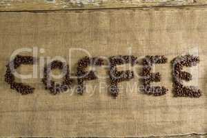 Word coffee arranged with coffee beans