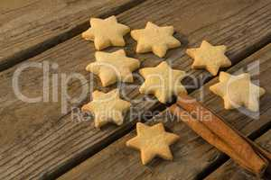 Close up of Christmas tree made with star shape cookie and cinnamon stick