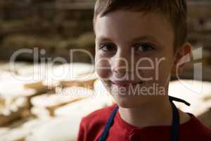 Smiling boy in pottery workshop