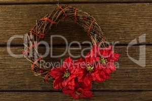 Overhead view of wreath with poinsettia flowers