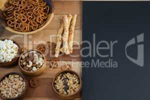Various snacks on wooden table