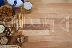 Fresh snacks and beer on wooden table