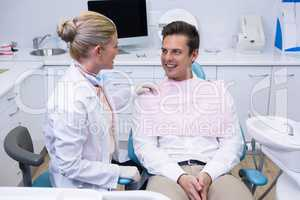 Patient looking at dentist at medical clinic
