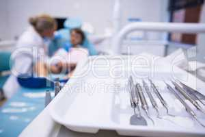 Close up of medical equipment on tray by dentist examining boy