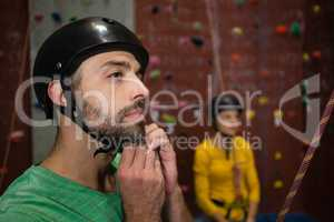 Male athlete wearing sports helmet in health club
