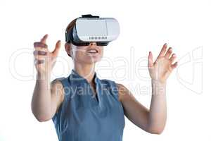 Happy young businesswoman gesturing while wearing virtual reality glasses