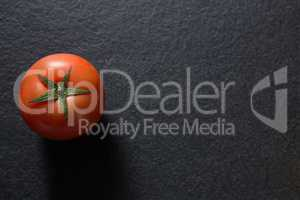 Tomato on black background