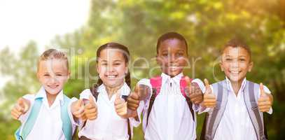 Composite image of portrait of students showing thumbs up sign