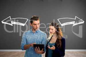 Composite image of concentrated business people using a digital tablet